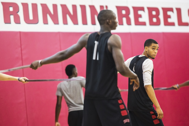 UNLV sophomore guard Jalen Poyser, right, stretches before practice at the Mendenhall Center at UNLV on Monday, August 1, 2016, in Las Vegas. (Benjamin Hager/Las Vegas Review-Journal)