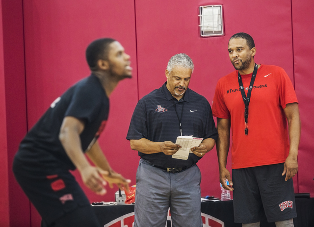 UNLV assistant coach Rob Jeter, right, and head coach Marvin Menzies look over their roster at the Mendenhall Center at UNLV on Monday, August 1, 2016, in Las Vegas. (Benjamin Hager/Las Vegas Revi ...