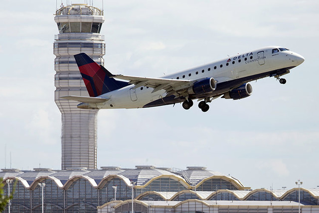 A Delta Air Lines jet takes off from Ronald Reagan Washington National Airport in Arlington, Va, in 2014.  (Manuel Balce Ceneta/The Associated Press)