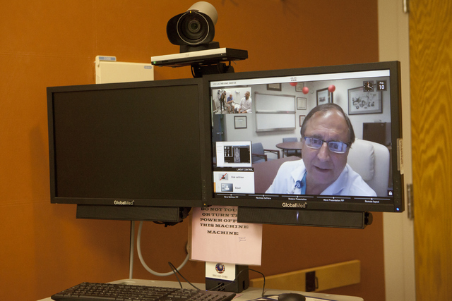 Dr. John Frazee of the West Los Angeles VA Medical Center, consults with his patient, Ray Burroughs, using telemedicine technology on Wednesday, June 10, 2016, at the North Las Vegas VA Medical Ce ...