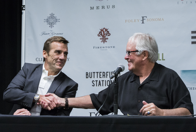 Bill Foley, right, owner of Las Vegas' NHL expansion team, shakes hands with George McPhee, the team's new general manager, at T-Mobile Arena on Wednesday, July 13, 2016, in Las Vegas. (Benjamin ...