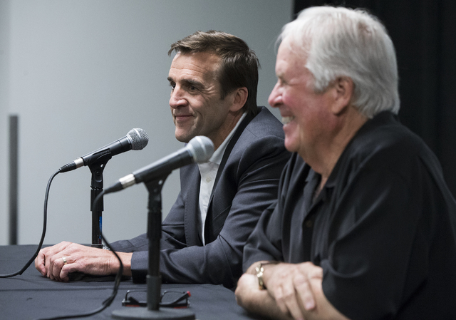 George McPhee, left, the new general manager of Las Vegas' NHL expansion team, answers questions at a press conference at T-Mobile Arena on Wednesday, July 13, 2016, in Las Vegas. (Benjamin Hage ...