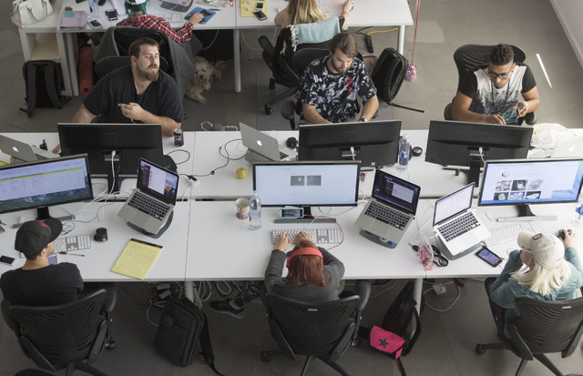 Influential employees work at theirs desks in a Soho Lofts penthouse in downtown Las Vegas on Monday, Aug. 15, 2016. Richard Brian/Las Vegas Review-Journal Follow @vegasphotograph