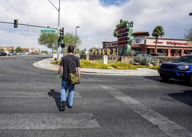 A man crosses Durango Drive and Warm Springs Road near the Desert Marketplace on Thursday, Aug. 18, 2016. Jeff Scheid/Las Vegas Review-Journal Follow @jeffscheid