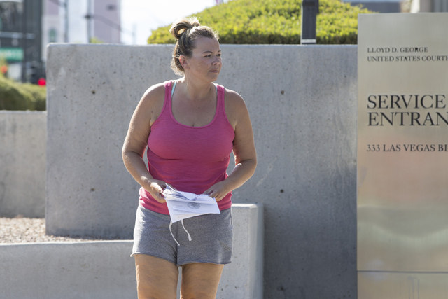 Jennifer McCain-Bray, a former purchasing analyst, leaves the Lloyd George U.S. Courthouse after pleading not guilty to six mail fraud charges on Thursday, July 28, 2016, in Las Vegas. (Erik Verdu ...