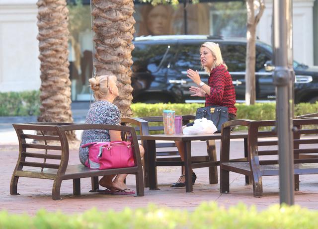 Two women sitting at Town Square Park chat during the cooler weather on Tuesday, Aug. 23, 2016, in Las Vegas. (Bizuayehu Tesfaye/Las Vegas Review-Journal Follow @bizutesfaye)