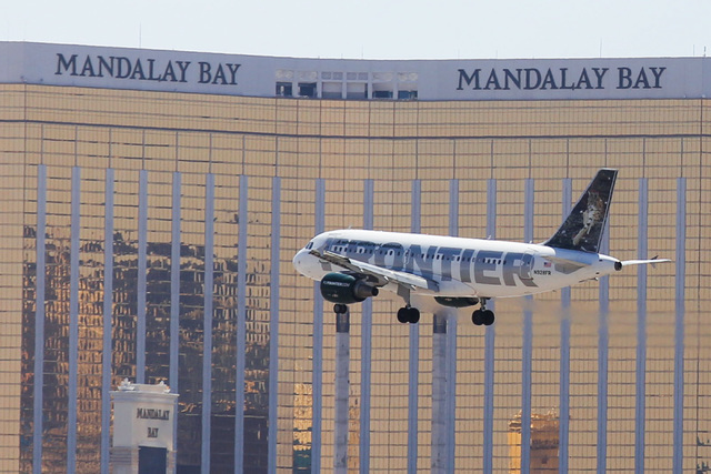 A Frontier Airlines flight passes in front of the Mandalay Bay hotel-casino on approach to McCarran International Airport on Friday, June 3, 2016 in Las Vegas. (Brett Le Blanc/Las Vegas Review-Jou ...