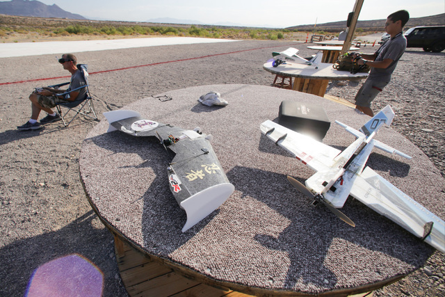 Scott Duncan, 59, of Pahrump, left, and Daryl Tingley, 28, fly radio-controlled aircraft at the Las Vegas Soaring Club off state Route 159 in Calico Basin July 28. The club plans to celebrate 80 y ...