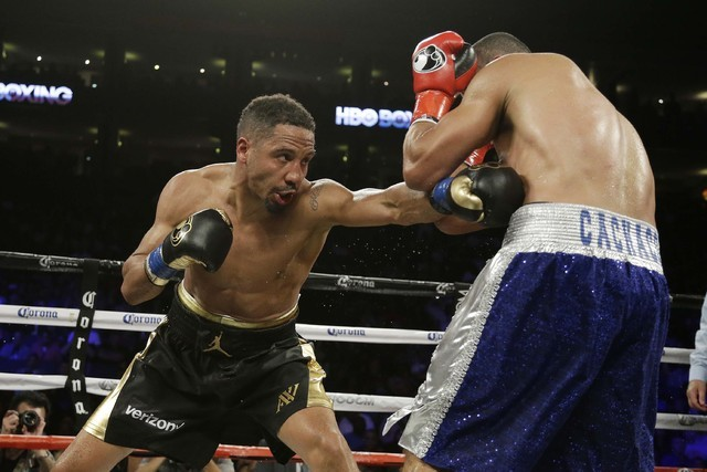 Andre Ward, left, punches Alexander Brand, of Colombia, right, during the 12th round of their light heavyweight boxing match Saturday, Aug. 6, 2016, in Oakland, Calif. Ward won the fight in a unan ...