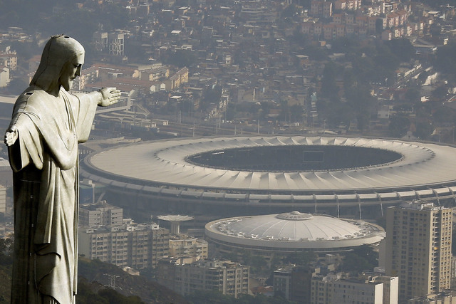 An aerial view shows the Christ the Redeemer statue with the Maracana stadium, where the opening cermony of the Rio 2016 Olympic Games will be held, in Rio de Janeiro, Brazil, July 16, 2016. REUTE ...
