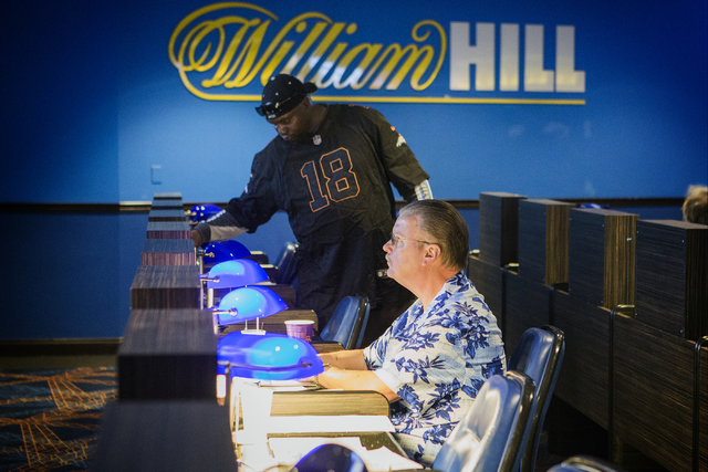 Steve Lewis, from Kansas City, watches a horse race on a TV monitor at the William Hill Race & Sports Book in the Plaza hotel-casino on Friday, March 18, 2016. (Jeff Scheid/Las Vegas Review-Jo ...