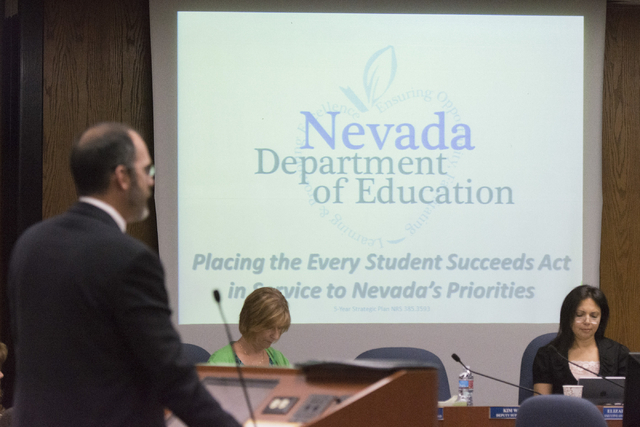 Superintendent of Public Instruction for the Nevada Department of Education Steve Canavero, left, speaks to Clark County School District Trustees about the Every Student Succeeds Act at the Greer  ...