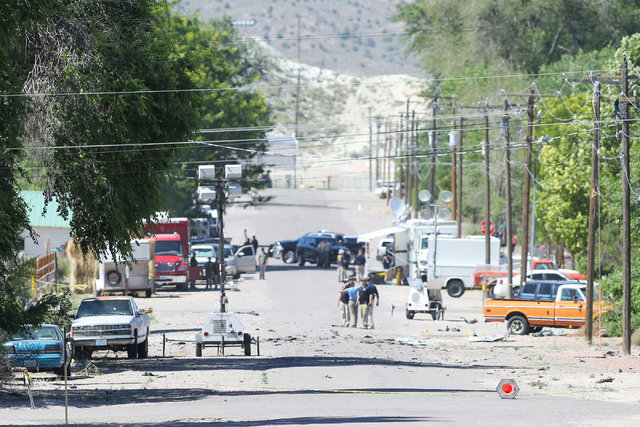 Police investigate shrapnel from a bombing that killed one person on Fifth Street in Panaca, Nev., on Thursday, July 14, 2016. (Brett Le Blanc/Las Vegas Review-Journal) Follow @bleblancphoto