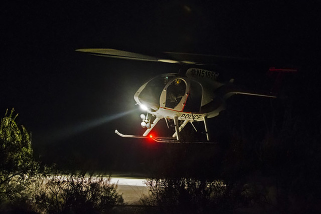 A law enforcement helicopter lands at a helicopter pad to assist with a hikers death at the overlook at Red Rock Canyon National Conservation Area on Thursday, Aug. 25, 2016, in Las Vegas.  (Benja ...