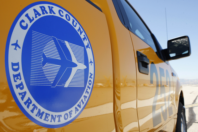 A Clark County Department Of Aviation vehicle is seen on the east west runway at McCarran International Airport in Las Vegas during a tour Wednesday, Oct. 29, 2014. The east west runway at the air ...
