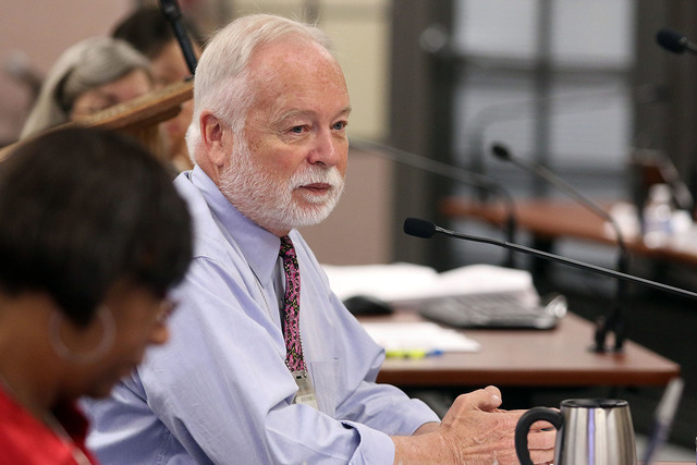 Dr. Joseph Iser, chief medical officer for Southern Nevada Health District, appears before the Southern Nevada District Board of Health during a monthly meeting, May 28, 2015, in Las Vegas.  (Rond ...