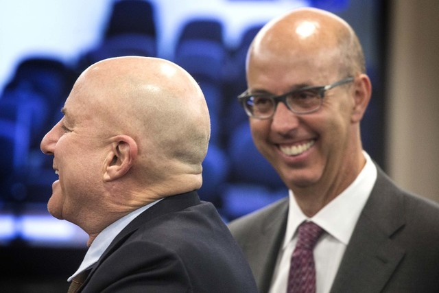 Scientific Games executives Ronald O. Perelman, left, chairman and Gavin Isaacs, CEO,  during the Nevada Gaming Commission hearing on the company's buyout of Bally Technologies on Thursday, Nov. 2 ...