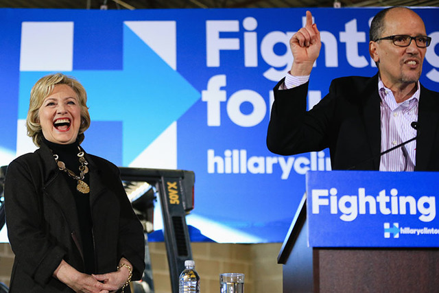 Democratic presidential candidate Hillary Clinton laughs as Labor Secretary Tom Perez endorses her during a campaign stop in Sioux City, Iowa, Friday, Dec. 4, 2015. (AP Photo/Nati Harnik)