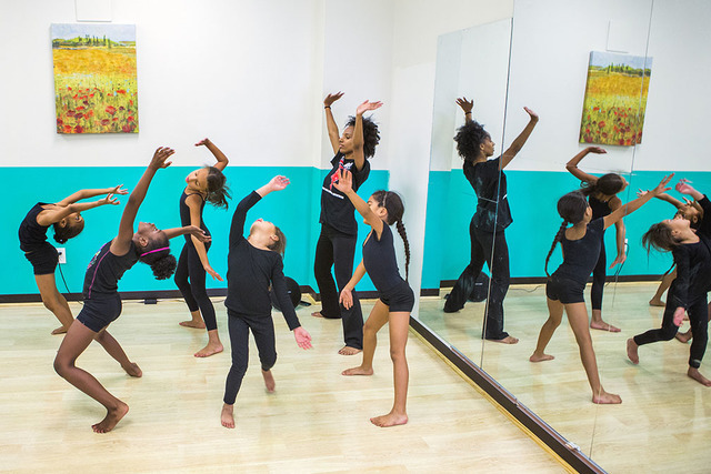 Kids dance during at the Rolle Project, a non profit dance education organization, at  R.A.G.E. (Reaching Above Greater Expectations), 3251 W. Craig Road, on Tuesday, July 19, 2016. The summer pro ...