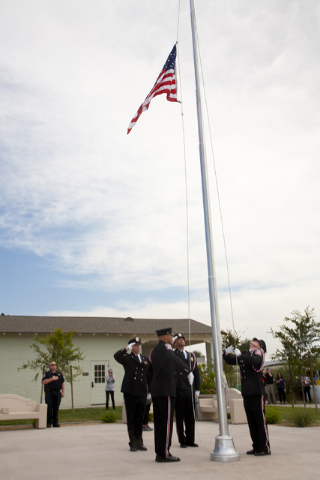 The Las Vegas Fire & Rescue Honor Guard raises the flag during the singing of the National Anthem at the Historic Westside School in Las Vegas on Saturday Aug. 27, 2016. (Jeferson Applegate/La ...