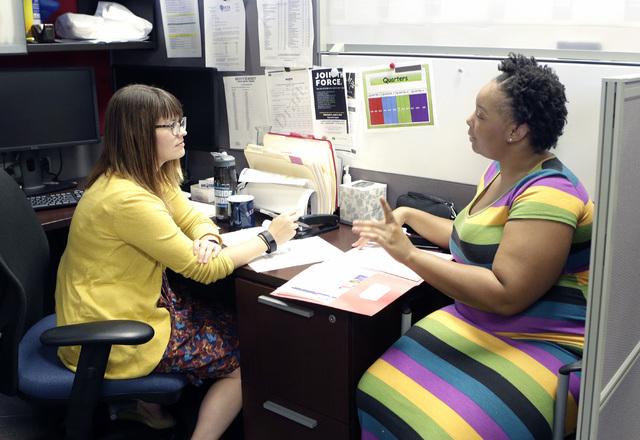 Ashley Kahr, left, talent development specialist at Workforce-Connections at 6330 W. Charleston Blvd., listens to massage therapist Tanisha Jones on Monday, Aug. 1, 2016. Bizuayehu Tesfaye/Las Veg ...