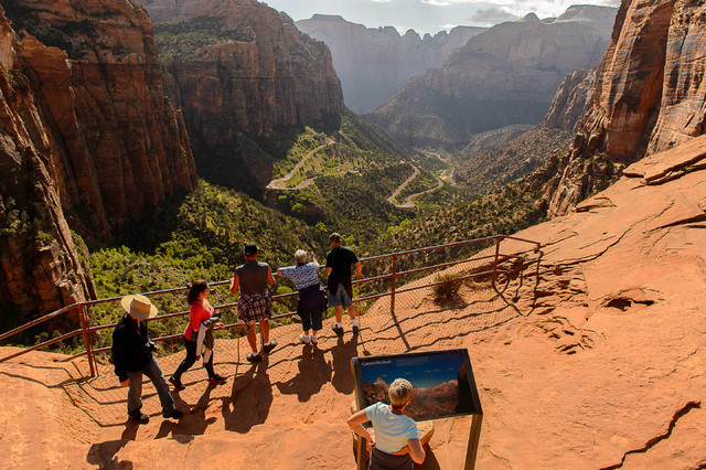 Hikers enjoy the Canyon Overlook Trail in Zion National Park in 2015. (Trent Nelson /The Salt Lake Tribune via AP)