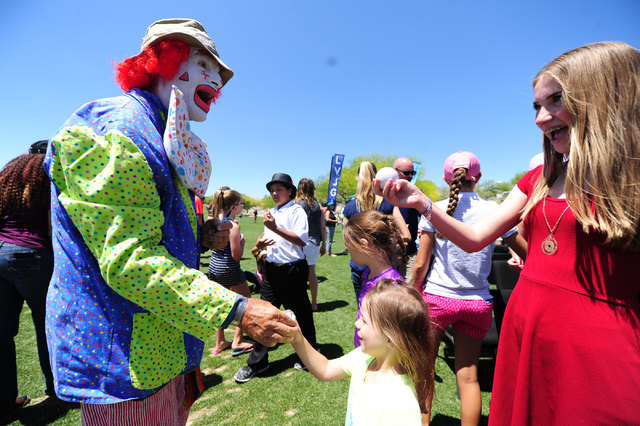 Kevin Compare, AKA Divot The Clown, signs autographs for fan after his performance during the 2016 Area Wide Junior Clinic and PGA Junior League Kickoff at TPC Las Vegas in Las Vegas Saturday, May ...