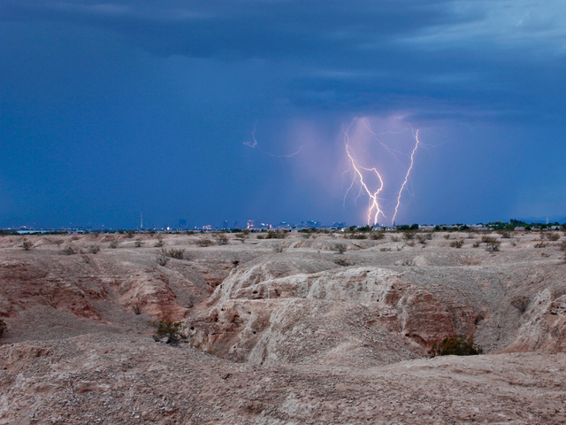 """Lightning flashes above Tule Springs Fossil Beds National Monument in a photo by Bruce Loeffler included in the """"Home Means Nevada"""" exhibit now on display at the Senate Russell Building on Capitol ..."""