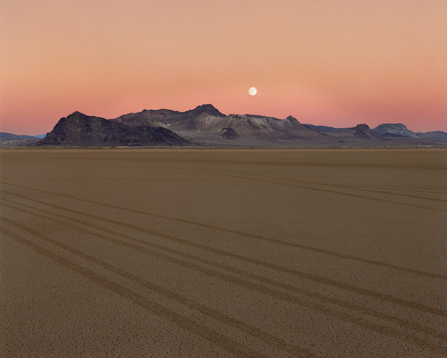 """The moon hangs above the Black Rock Desert in artist Peter Goin's photo from the """"Home Means Nevada"""" exhibit now on display at the Senate Russell Building on Capitol Hill. (Courtesy of National Pa ..."""