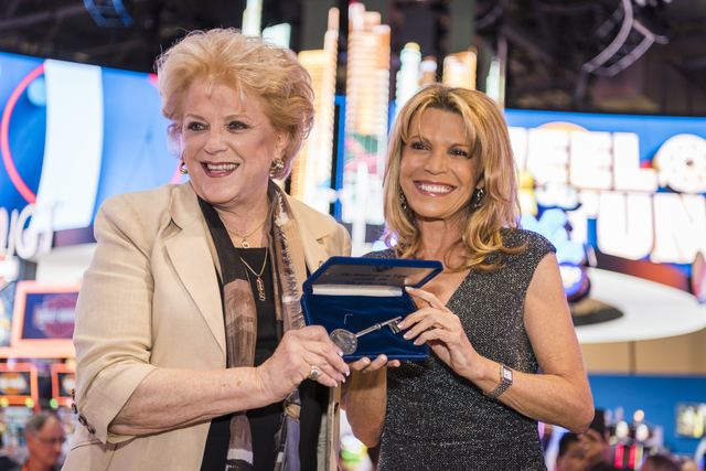 Vanna White, right, receives the Key to the City from Mayor Carolyn Goodman at the 2016 Global Gaming Expo on Tuesday, Sept. 27, 2016, in Las Vegas. (IGT)
