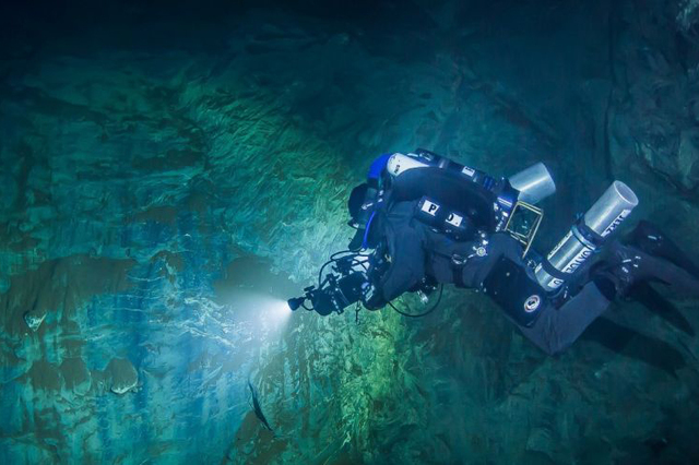 In this underwater photo taken Aug. 15, 2015 in the flooded Hranicka Propast, or Hranice Abyss, in the Czech Republic Polish explorer Slawomir Packo is exploring the limestone abyss and preparing  ...