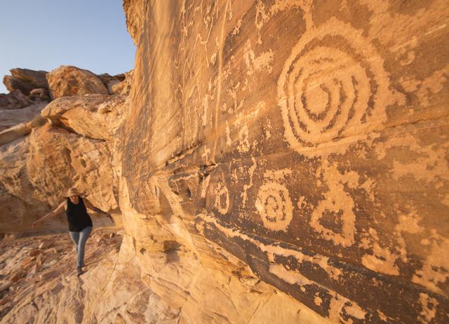 """A panel of petroglyphs greets a visitor to the Gold Butte area in this image by Las Vegas-based international photographer Mike Hill featured in the """"Home Means Nevada"""" exhibit n ..."""