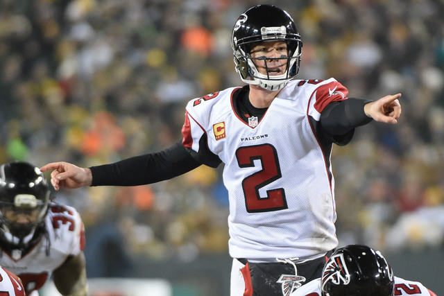 Dec 8, 2014; Green Bay, WI, USA; Atlanta Falcons quarterback Matt Ryan (2) calls a play in the third quarter during the game against the Green Bay Packers at Lambeau Field. (Benny Sieu/USA Today S ...