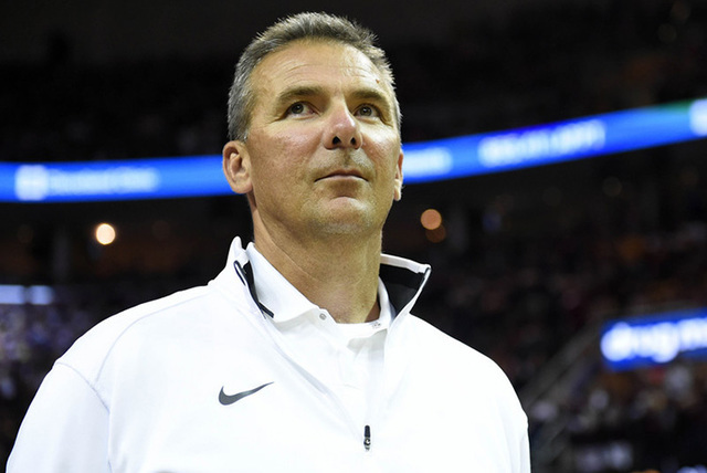 Jun 9, 2015; Cleveland, OH, USA; Ohio State Buckeyes football coach Urban Meyer in game three of the NBA Finals between the Golden State Warriors and the Cleveland Cavaliers at Quicken Loans Arena ...