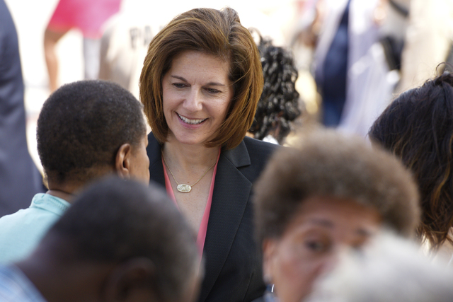 U.S. Senate candidate and former Nevada Attorney General Catherine Cortez Masto speaks with people during the dedication of the rehabilitated historic Westside School Saturday, Aug. 27, 2016. (Sam ...