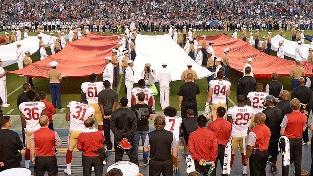 Sep 1, 2016; San Diego, CA, USA;  San Francisco 49ers quarterback Colin Kaepernick (7, bottom middle) kneels during the national anthem before the game against the San Diego Chargers at Qualcomm S ...