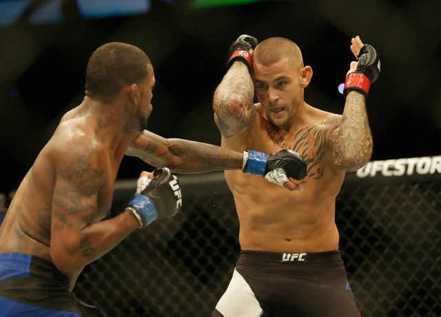 Dustin Poirier (red gloves) competes against Michael Johnson (blue gloves) during UFC Fight Night at State Farm Arena in Hidalgo, Texas. (Sean Porkorny-USA TODAY Sports)