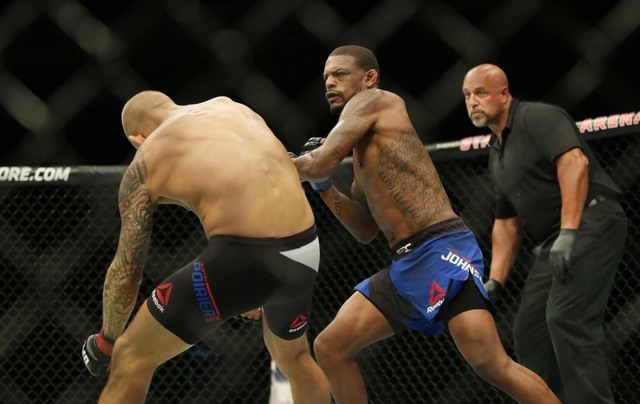 Dustin Poirier gets knocked down by Michael Johnson during UFC Fight Night at State Farm Arena in Hidalgo, Texas. (Sean Porkorny-USA TODAY Sports)