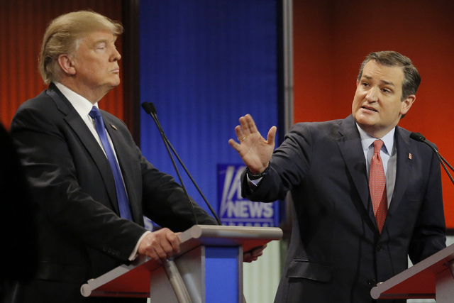 Republican presidential candidate Ted Cruz gestures at rival candidate Donald Trump at the Republican presidential candidates debate in Detroit, March 3, 2016. (Jim Young/Reuters)