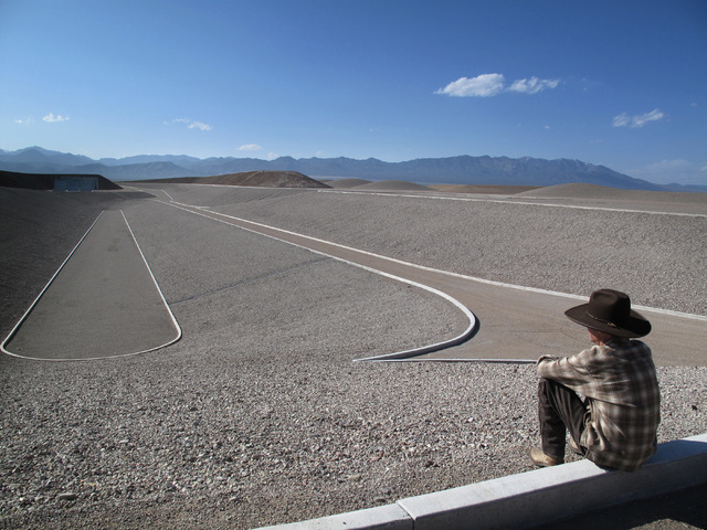 """Artist Michael Heizer looks out over his massive earthwork """"City"""" in a photo taken by Michael Govan, CEO of the Los Angeles County Museum of Art, and featured in the """"Home Means Nevada"""" exhibit no ..."""