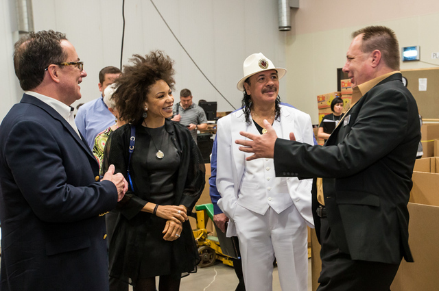Carlos Santana and Cindy Blackman tour Three Square food bank in Las Vegas. (Courtesy photos by Erik Kabik)