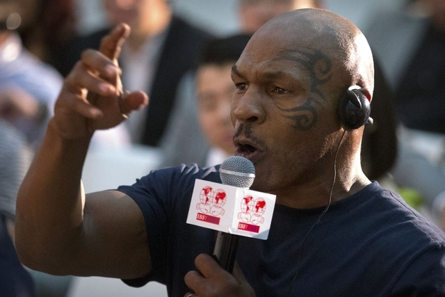 Former heavyweight boxing champion Mike Tyson speaks during a panel discussion held before the 2016 IBF World Championship Bout at the National Tennis Center in Beijing, Wednesday, May 25, 2016. ( ...