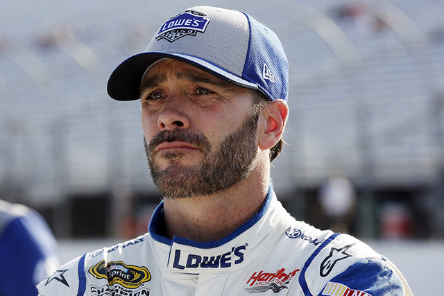NASCAR driver Jimmie Johnson watches the clock runout during qualifying at New Hampshire Motor Speedway for Sunday's New Hampshire 301 auto race Friday, July 15, 2016, in Loudon, N.H. Johnson won  ...