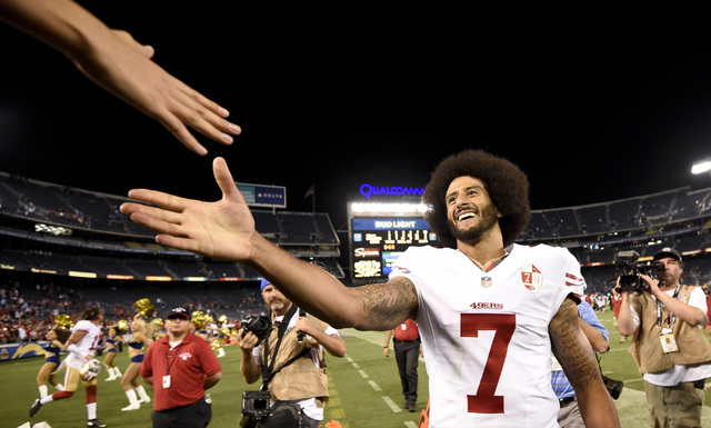 San Francisco 49ers quarterback Colin Kaepernick shakes hands with fans after the 49ers defeated the San Diego Chargers 31-21 during an NFL preseason football game Thursday, Sept. 1, 2016, in San  ...