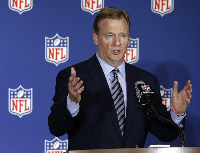In this May 24, 2016, file photo, NFL commissioner Roger Goodell answers reporter's questions at an NFL owner's meeting in Charlotte N.C.  Goodell disagrees with Colin Kaepernick's choice to kneel ...