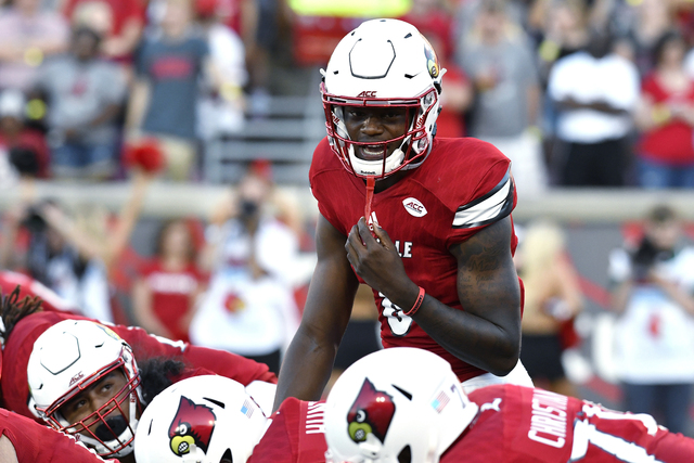 In this Sept. 1, 2016, file photo, Louisville quarterback Lamar Jackson calls out at the line of scrimmage during the team's NCAA college football game against Charlotte in Louisville, Ky. (Timoth ...