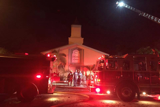 In this photo provided by the St. Lucie Sheriff's Office, firefighters work at the scene of a fire at the Islamic Center of Fort Pierce on Monday, Sept. 12, 2016, in Fort Pierce, Florida. (St. Luc ...