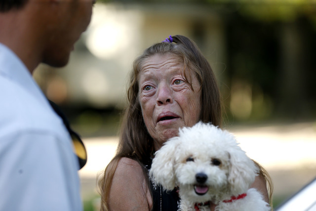 David Phung, who rescued Hailey Brouillette and her dog Sassy from her sinking car in recent floodwaters, reunites with her for the first time on Monday, Sept. 12, 2016. (Gerald Herbert/AP)