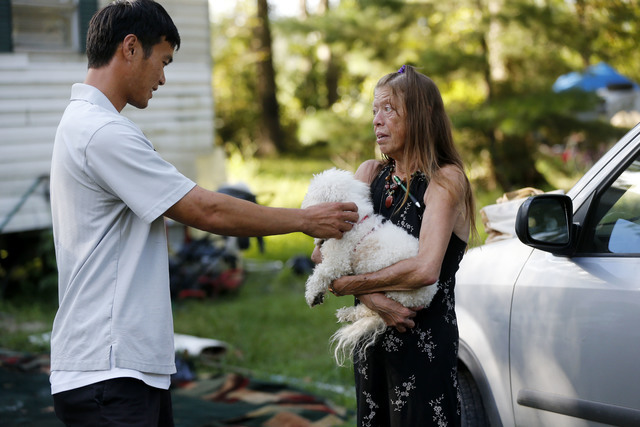 David Phung, who rescued Hailey Brouillette and her dog Sassy from her sinking car in recent floodwaters, reunites with her for the first time in Denham Springs, Louisiana on Monday, Sept. 12, 201 ...