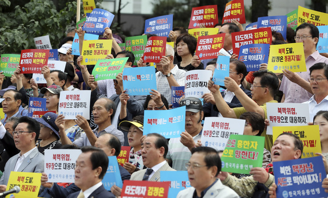 South Korean shout slogans during a rally denouncing North Korea's latest nuclear test in Seoul, South Korea, Monday, Sept. 12, 2016. North Korea is capable of detonating another nuclear device an ...